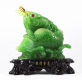 Jade sculpture. The statue of powerful in Chinese belief made from jade Stock Photography