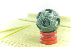Jade sphere on the rug Royalty Free Stock Image