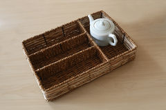 A jade teapot, with woven rattan box. This tea culture places emphasis on the taste and color of the tea as well as on the presentation of the tea set Royalty Free Stock Photos