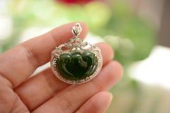 Jadeite framed by silver Stock Photo