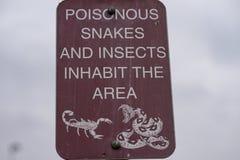 JADOWITY węży & insektów znak fotografia royalty free