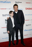 Jaeden Lieberher and Clive Owen Royalty Free Stock Image