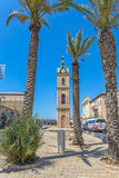 Jaffa Clock Tower and palm trees Royalty Free Stock Photos