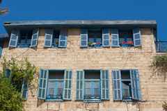 Jaffa house with blue windows Royalty Free Stock Image
