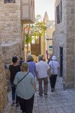 Tourists and travelers to the stone streets of the ancient city of Jaffa, Israel Royalty Free Stock Images
