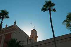 Jaffa, Old City, Israel, Middle East. View of the bell tower of St. Peter's Church with the palms in the Old City on August 31, 2015. St. Peter's church is is a stock images