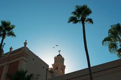 Jaffa, Old City, Israel, Middle East, St. Peter`s Church, bell tower, palm tree. View of the bell tower of St. Peter`s Church with the palms in the Old City on royalty free stock photography