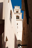 Jaffa, Old City, Israel, Middle East. View of the bell tower of St. Peter's Church trough an alley in the Old City on August 31, 2015. St. Peter's church is is a royalty free stock images