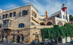 Jaffa in Tel Aviv. Tel Aviv, Israel - October 20, 2015. Houses and lighthouse (right) in Jaffa also called Japho or Joppa, former port city, now part of Tel Aviv Royalty Free Stock Photography