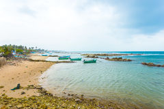 Jaffna Point Pedro Fishing Boats Coast Ocean H. Fishing boats anchored outside a fishermen village in Point Pedro on a stormy day along the northern coast of royalty free stock photo