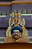 Man`s head holy deity wood carving with fierce mythical animal creature at Nallur Kandaswamy Hindu temple Jaffna Sri Lanka. Jaffna, Sri Lanka - February 17, 2017 royalty free stock image