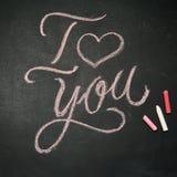 jag älskar dig Handskrivet meddelande på en svart tavla Fotografering för Bildbyråer