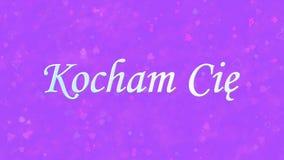 Jag älskar dig text i polska Kocham Cie på purpurfärgad bakgrund Arkivbild