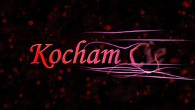 Jag älskar dig text i polska Kocham Cie vänd för att damma av från rätt på mörk bakgrund Royaltyfria Foton