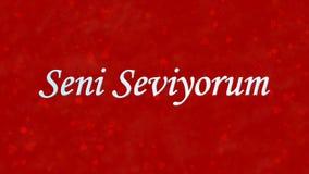 Jag älskar dig text i turk Seni Seviyorum på röd bakgrund Royaltyfri Fotografi