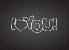 Jag älskar dig text på mörker texturerad bakgrund Arkivfoto