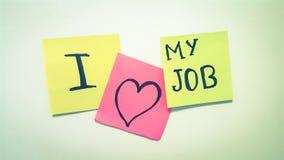 Jag älskar mina för begreppspapper för jobbet företags klistermärkear Arkivfoton