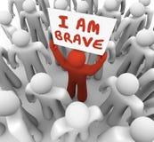 Jag är modig satt en klocka på handling för man Person Holding Sign Courage Daring Arkivfoton