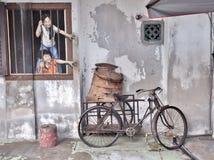JAG ÖNSKAR BAO, vägg- gatakonst i den Georgetown staden, Penang, Malaysia Arkivfoton