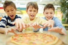 Jag önskar pizza! Fotografering för Bildbyråer