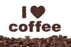 Jag älskar kaffe som är skriftligt i bönor Arkivbilder