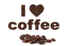 Jag älskar kaffe som är skriftligt med bönor Arkivbild
