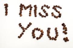 Jag missa dig tecknet med kaffebönor över vit bakgrund Arkivbild
