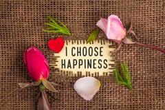 Jag väljer lycka som är skriftlig i hål på säckväven arkivfoto