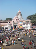 The Jagannath Temple in Puri. India: the Jagannath Temple in Puri and pilgrims. It is a famous Hindu temple dedicated to Jagannath (Vishnu) and located in the Royalty Free Stock Photos