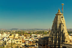 Jagdish Temple in Udaipur. Arial view on buildings and beautiful Jagdish Temple in Udaipur, India against blue sky stock image