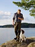 Jager en puppy royalty-vrije stock foto