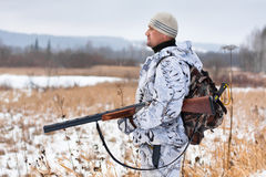 Jager op het sneeuwgebied royalty-vrije stock foto