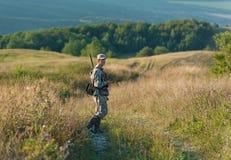 Jager in platteland Royalty-vrije Stock Afbeelding