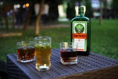 Bottle of Jagermeister and glasses Royalty Free Stock Image