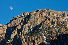 Jagged Mountains with Moon. Jagged Mountain Top with Moon Filled Sky Stock Image