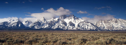 Jagged Peaks Grand Teton Wyoming Bright Sun Snow Clouds Royalty Free Stock Photos
