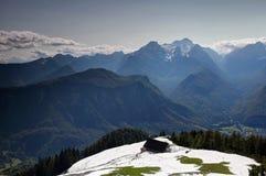 Jagged peaks of Julian Alps from snowy Karavanke range Slovenia royalty free stock photography