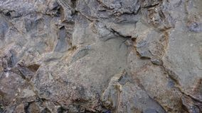 Jagged Rock Background. A grey rock based background. stone jagged stock images