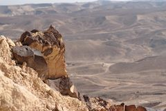 Jagged rock on the edge of the cliff in the desert Stock Photography