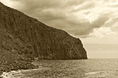 Rock seascape black and white. Jagged rock seascape black and white monotone landscape background travel environment scenic gezackter felsen Stock Image