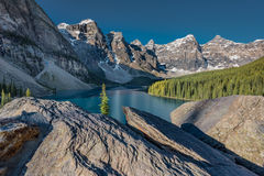 Jagged Rocks Above Moraine Lake. In the twn peaks valley Stock Photo