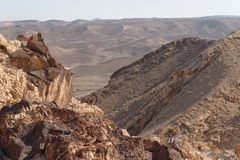 Jagged rocks on the edge of the cliff in the desert Royalty Free Stock Photo