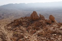 Jagged  rocks at the rim of desert canyon. In the Small Crater (Makhtesh Katan) in Negev desert, Israel Royalty Free Stock Photography