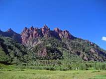 Jagged Rocky Mountain Peaks. Jagged reddish-brown Rocky Mountain peaks in summertime Stock Photo