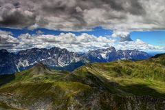 Jagged Sexten Dolomites with green slopes of Carnic Alps, Italy Royalty Free Stock Photos