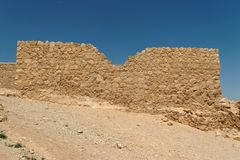 Jagged wall of ancient fortress  in the desert Royalty Free Stock Photos