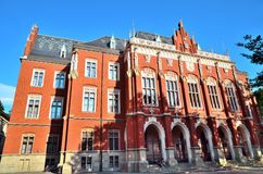 Jagiellon University at end of school year, Collegium Novum, Krakow, Poland. Krakow, Poland - July 5, 2016: Jagiellon University at end of school year, Collegium Stock Photo