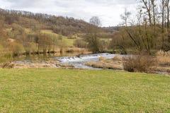 Jagst flod i Hohenlohe Arkivfoto