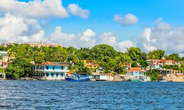 Jagua Cuban village with colorful houses on the hill and fishing boats,  Cienfuegos province, Cuba. America architecture bay building caribbean carribean coast royalty free stock photography