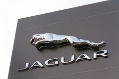 Jaguar car manufacturer company logo in front of dealership. PRAGUE, CZECH REPUBLIC - NOVEMBER 5: Jaguar car manufacturer company logo in front of dealership Stock Images
